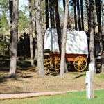 Fort Welikit Family Campground in Custer South Dakota offers tent camping, RV sites, rental cabins, and glamping tepees (tipis) and glamping covered wagon